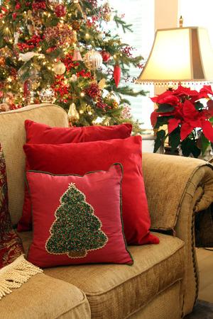 Cozy Christmas living room sofa with Christmas tree.