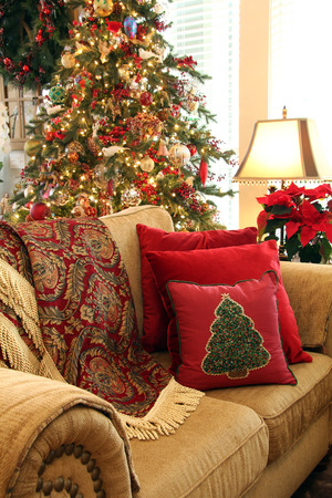 throw cushion: Cozy Christmas living room sofa with Christmas tree.