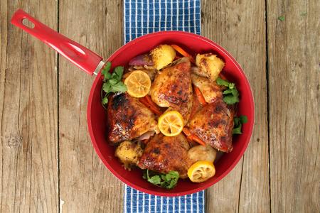 free range: Roasted free range organic Chicken dinner with potatoes, carrots, lemon and cilantro.