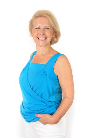Portrait of a beautiful stylish seventy year old lady with beautiful bright smile.  Studio shot, isolated on white. photo