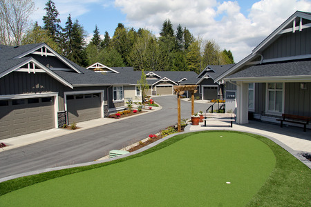 Luxury townhomes with a golf green.