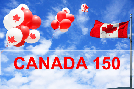 Canadian maple leaf flag and balloons in the sky for Canada 150 Birthday celebration.