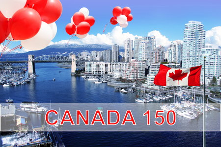 Canadian flag and balloons in front of view of False Creek and the Burrard street bridge in Vancouver, Canada for Canadas 150 Brithday celebration.