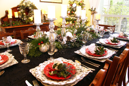 dining table and chairs: Traditional dining room table set for Christmas dinner.