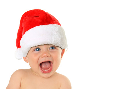 Adorable ten month old baby boy wearing a Santa hat. Studio isolated on white.