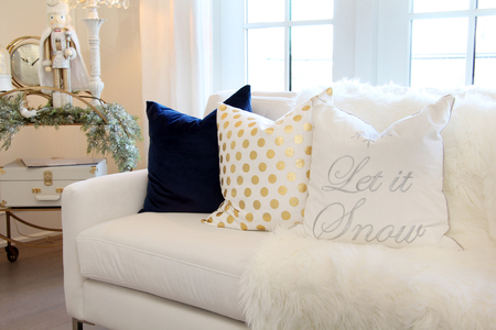 Luxurious white sofa with Christmas cushion and ornaments. Stock Photo
