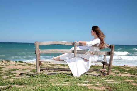 beautiful young woman relaxing on the bench Stock Photo