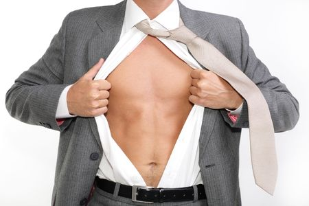 fit for business - young businessman dressed in suit, shirt and tie pulling his shirt open revealing well-built torso Stock Photo
