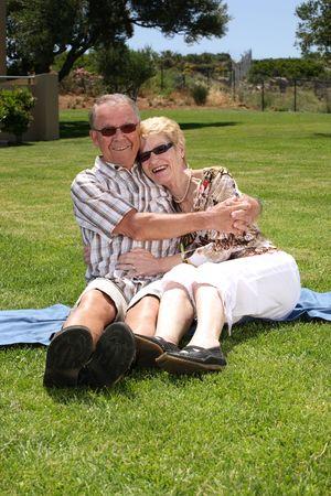romantic senior couple relaxing outdoors Stock Photo - 3270035