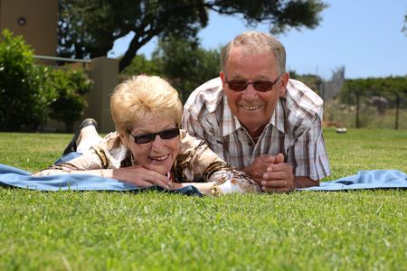 senior couple relaxing outdoors Stock Photo