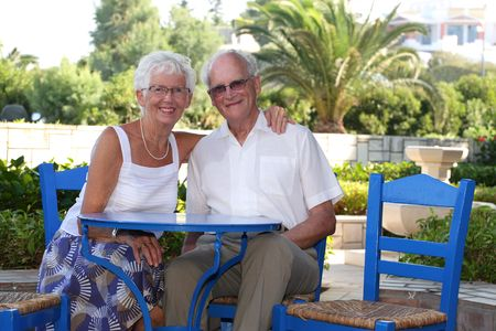 beautiful senior couple relaxing outdoors on a sunny day Stock Photo - 3400038