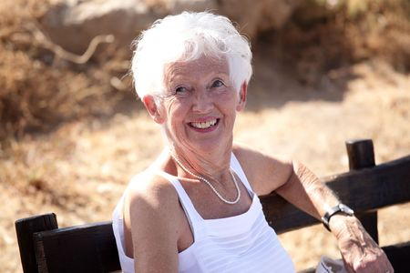 Portrait of a happy senior woman relaxing outdoors Stock Photo - 3488830