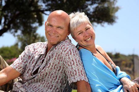 fulfilled: beautiful mature couple outdoors
