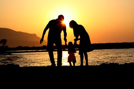 happy family of three playing silhouette