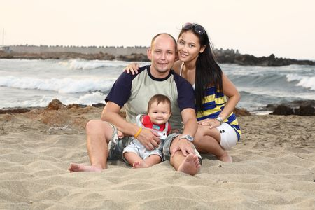 casual portrait of a  young happy family relaxing outdoors photo