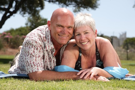 living moment: beautiful mature couple relaxing outdoors