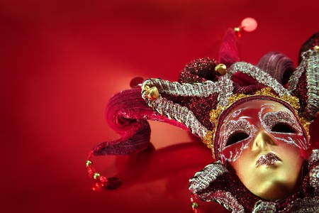 ornate carnival mask over textured metallic background photo