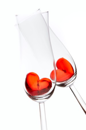 red jelly hearts in champagne glasses over white background photo