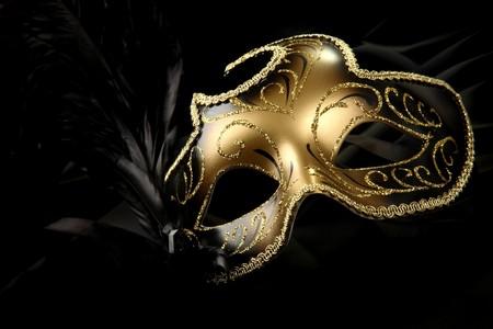 masquerade masks: ornate carnival mask over black silk background Stock Photo