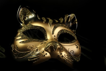 costume ball: ornate carnival mask over black silk background Stock Photo