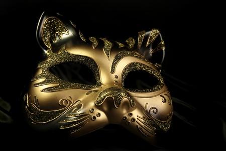 theatre costumes: ornate carnival mask over black silk background Stock Photo