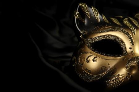 ornate carnival mask over black silk background photo