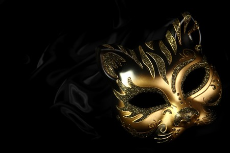theatre masks: ornate carnival mask over black silk background Stock Photo