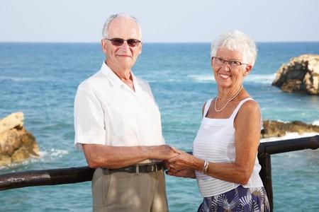 lady s: happy elderly couple holding hands