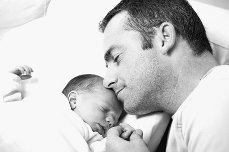 black and white close-up of father holding his newborn baby Stock Photo