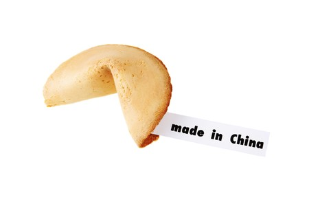 MADE IN CHINA - backlit single fortune cookie over white photo