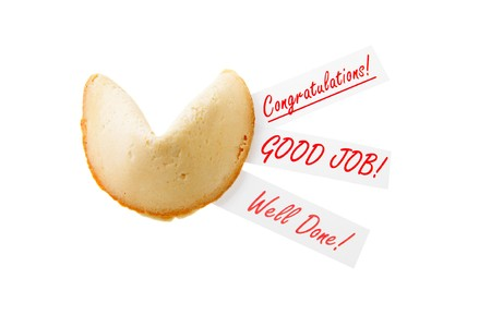 CONGRATULATIONS! - backlit single fortune cookie over white photo