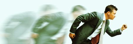 rat race! cross-processed blurred image of a young businessman racing photo