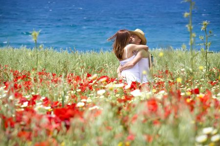 sexy girls kissing: Happy young couple on a meadow