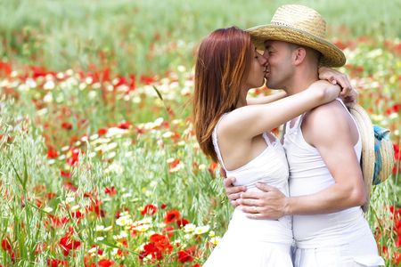 sexy couple kissing: Happy young couple on a meadow