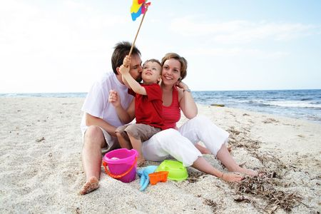 young happy family on the beach Stock Photo - 4863090