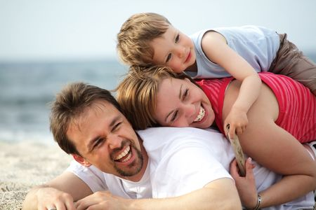 young happy family on the beach Stock Photo - 4863087