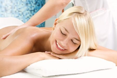 Beautiful young woman getting a spa treatment photo