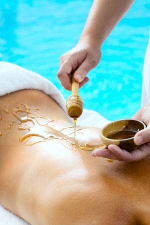 Back of a young woman getting a spa treatment Stock Photo - 5655158