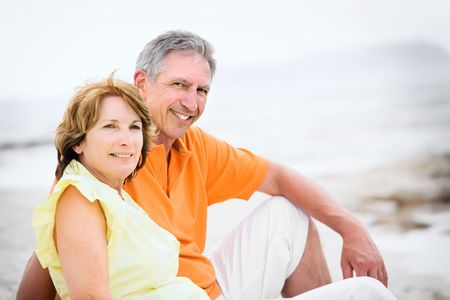 Close-up of a mature couple relaxing on the beach photo