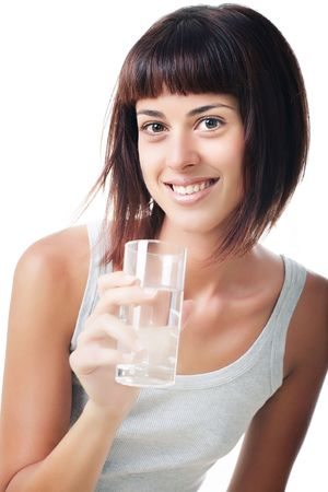 Beautiful smiling young woman holding a glass of water photo