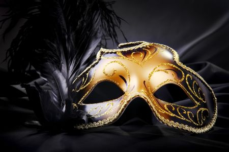 theatre mask: Carnival mask on black silk background Stock Photo