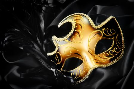 black mask: Carnival mask on black silk background Stock Photo