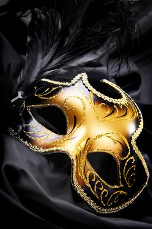 drama mask: Carnival mask on black silk background Stock Photo