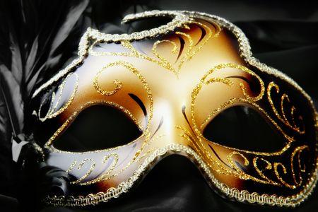 mardi: Carnival mask on black silk background Stock Photo