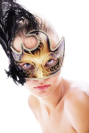 Beautiful young woman in carnival mask. Isolated on white background. photo