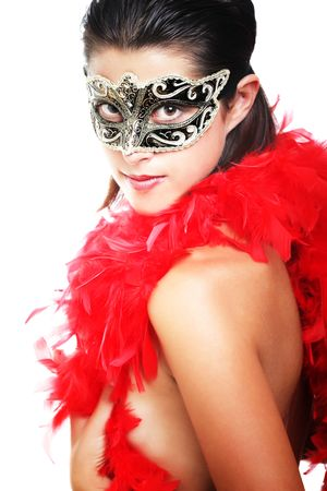 Beautiful young woman in carnival mask and feather boa photo