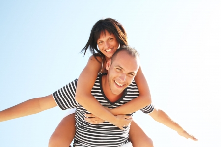 active girl: Smiling young couple having fun at the beach
