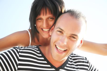 Smiling young couple having fun at the beach Stock Photo - 6203936