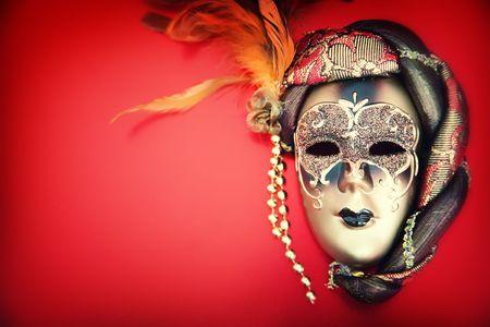 Ornate carnival mask over red background photo