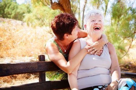 american seniors: Beautiful senior mother and daughter having fun